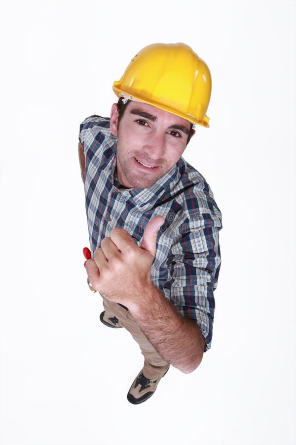 Trabalhador que dá o polegar acima. foto de stock royalty free
