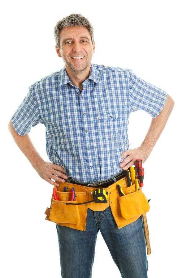 Trabalhador que desgasta o chapéu duro fotografia de stock royalty free