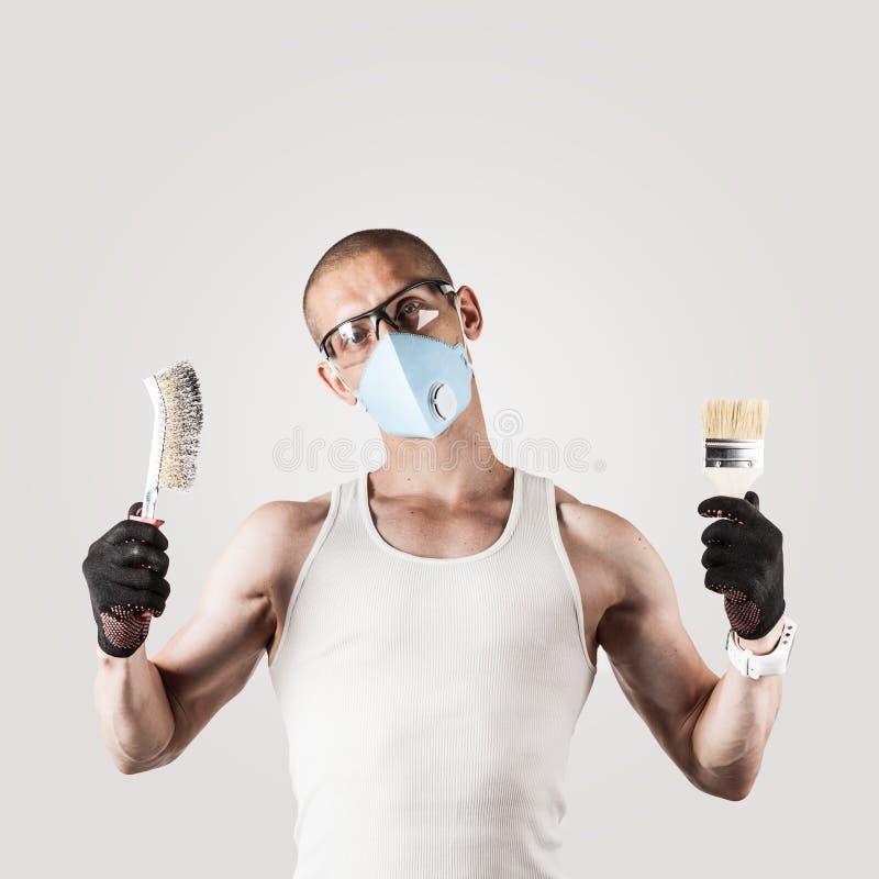 Trabalhador que veste uma máscara e vidros imagens de stock royalty free