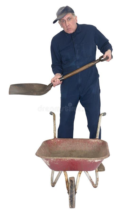 Trabalhador triste engraçado com a pá e o carrinho de mão isolados imagens de stock royalty free