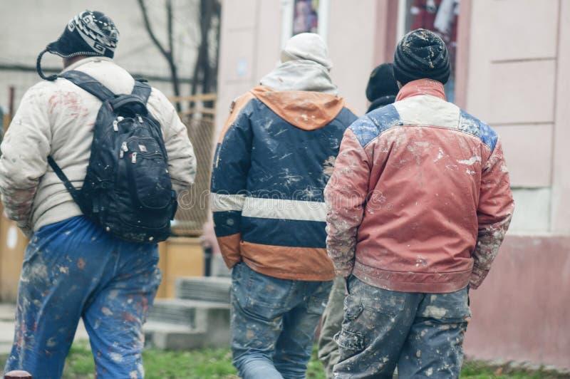 Trabalhadores com roupa pintada imagens de stock royalty free