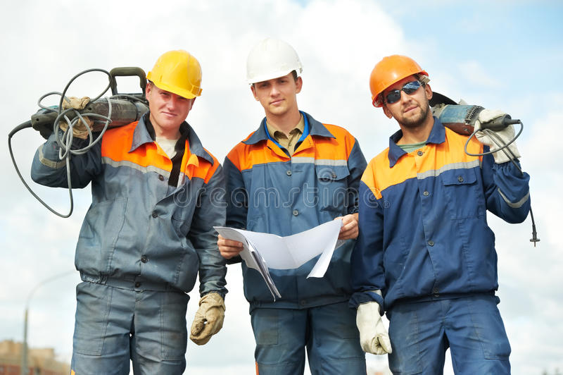 Trabalhadores da construção com ferramentas de potência fotografia de stock royalty free