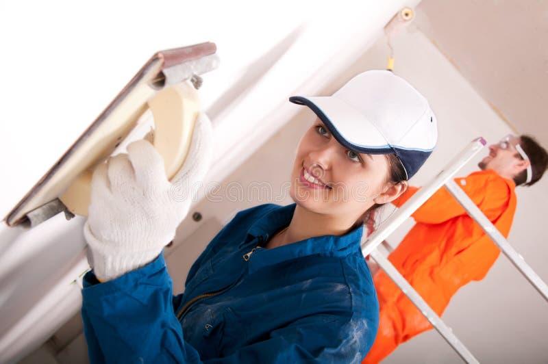 Trabalhadores da construção no trabalho fotografia de stock