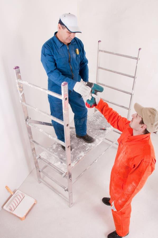 Trabalhadores da construção no trabalho foto de stock