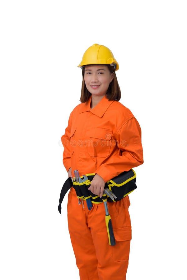 Trabalhadores da construção que vestem a roupa protetora alaranjada, capacete com a correia da ferramenta isolada no backround br imagens de stock royalty free