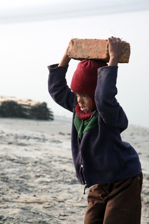 Trabalhadores da criança foto de stock