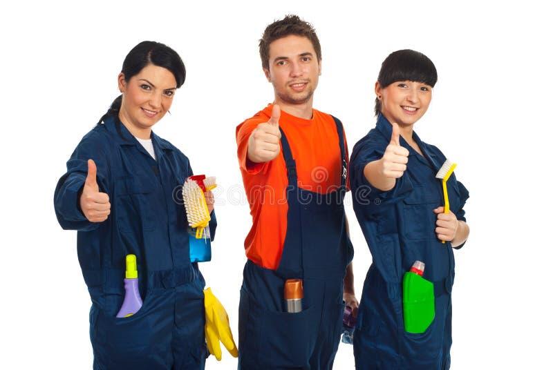 Trabalhadores da limpeza que dão os polegares acima imagem de stock