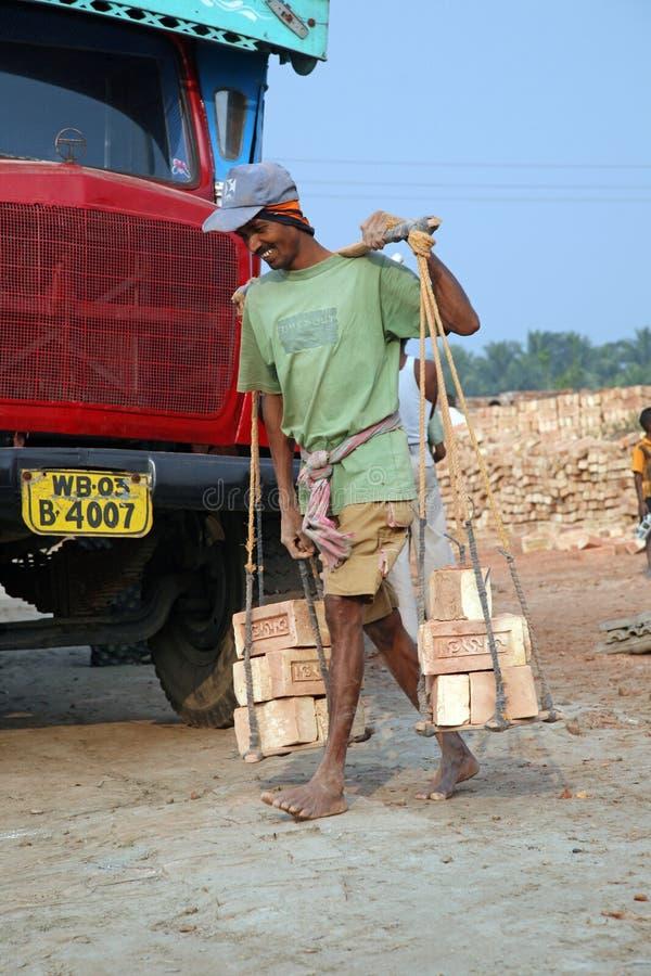 Trabalhadores de campo do tijolo foto de stock royalty free