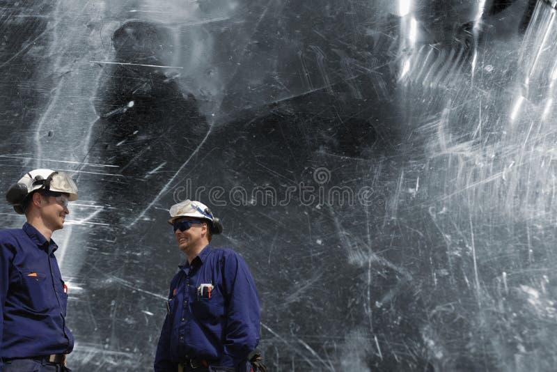 Trabalhadores e aço do metal fotografia de stock