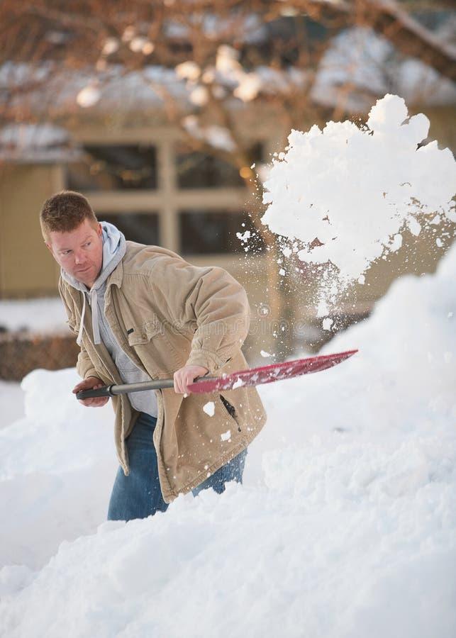 Trabalhando com pá a neve fotos de stock royalty free