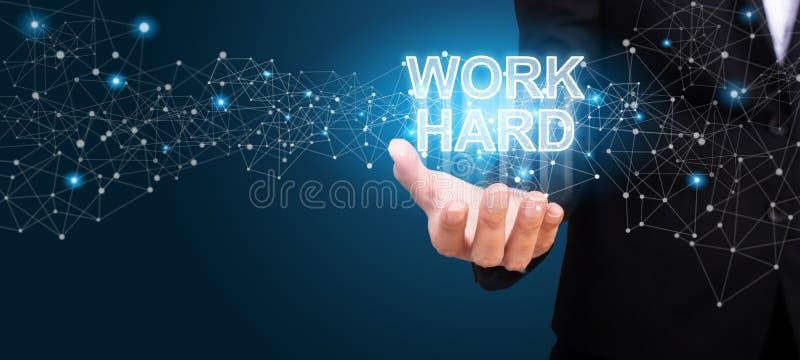 Trabalhe duramente na mão do negócio Conceito duro do trabalho imagens de stock