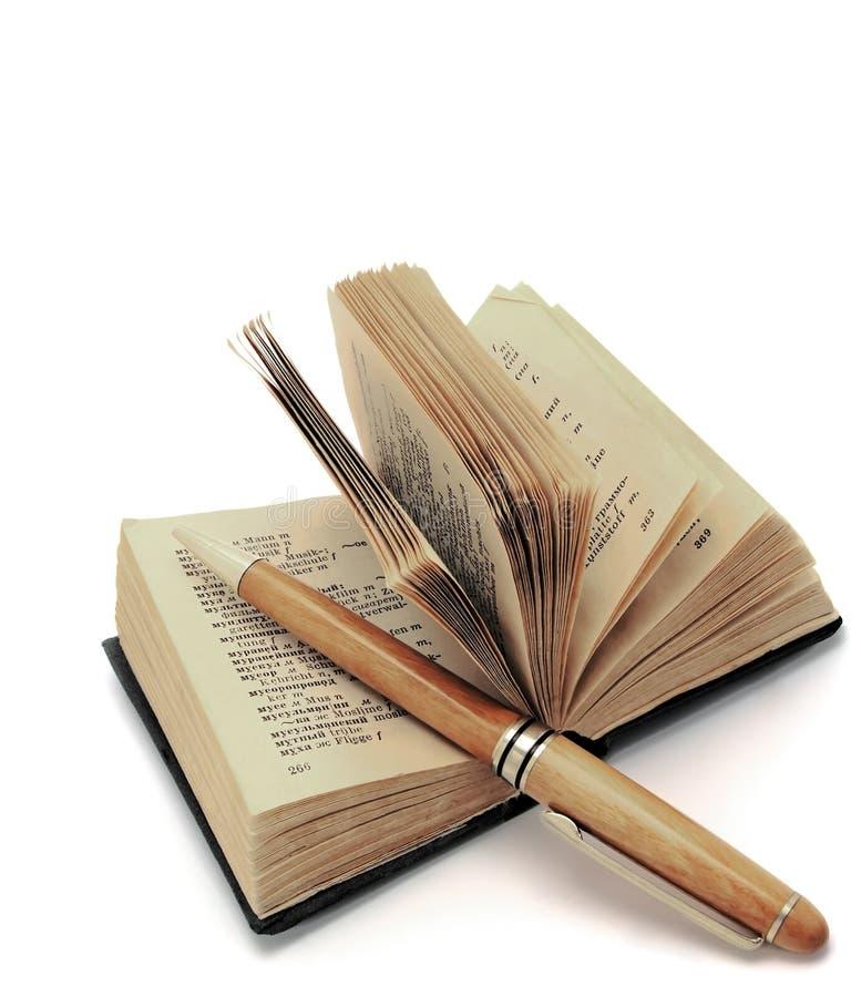 Trabalho com um dicionário. fotografia de stock
