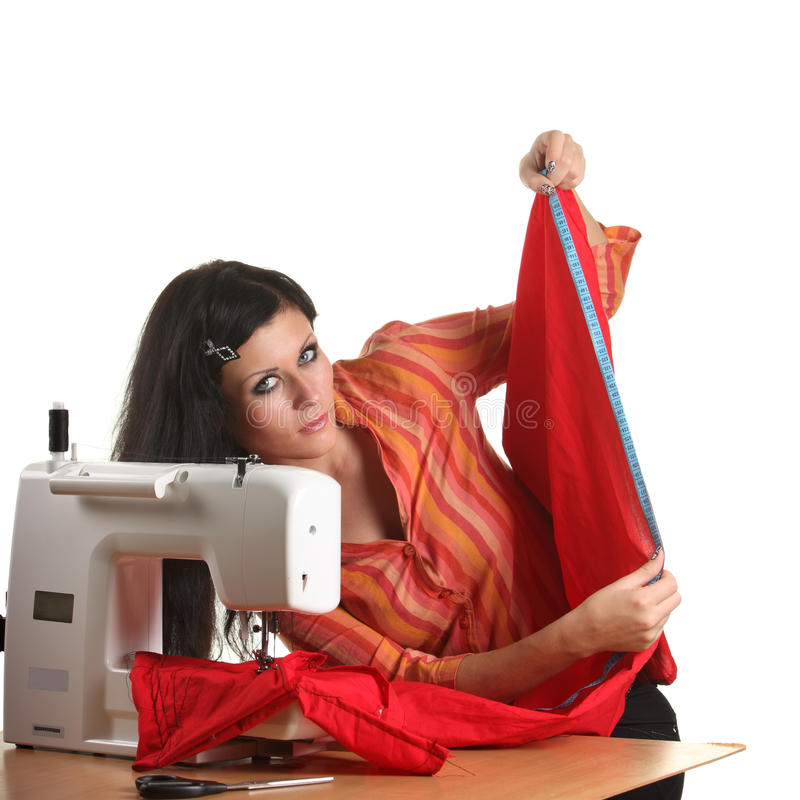 Trabalho da costureira na sewing-máquina foto de stock royalty free