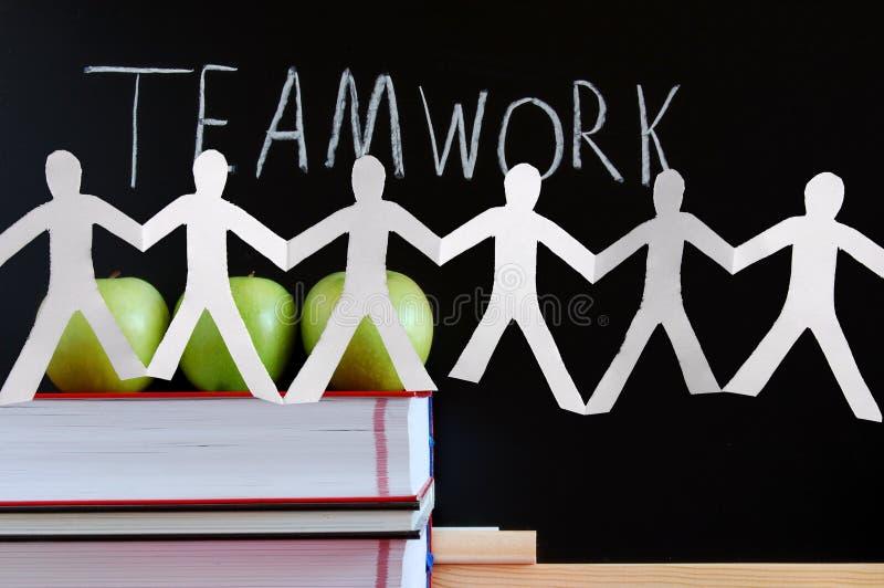 Trabalhos de equipa e quadro imagem de stock