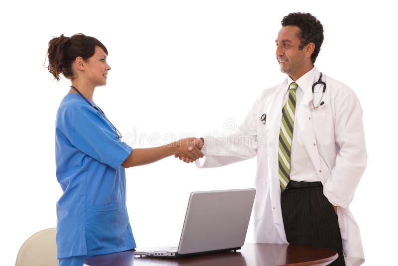 Trabalhos de equipa médicos foto de stock