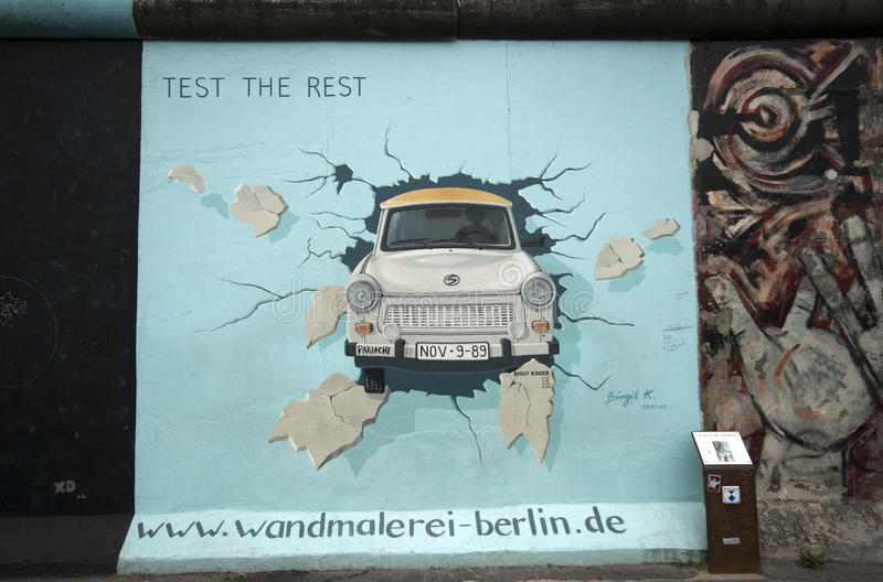 Trabant through Berlin Wall royalty free stock photo