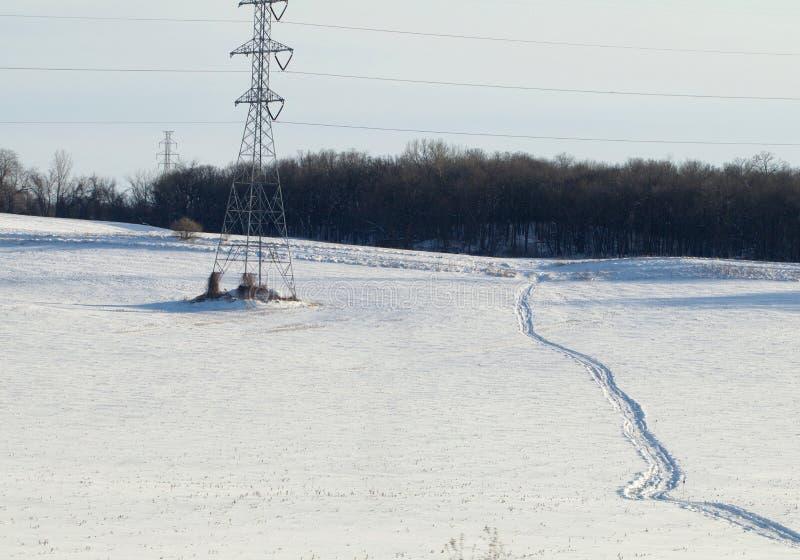 Traccia di gatto delle nevi fotografie stock