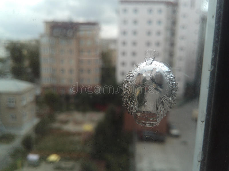 A trace from the bullet on the glass. royalty free stock photos