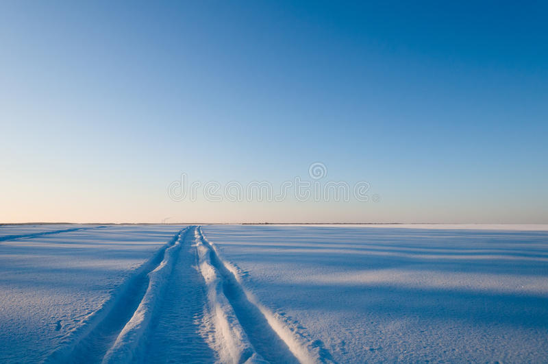 Download Trace Of Car On A Snowy Field Stock Photo - Image: 23009310