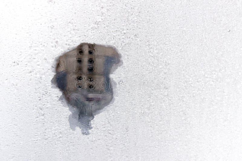 Trace de souffle sur une configuration givrée photos libres de droits