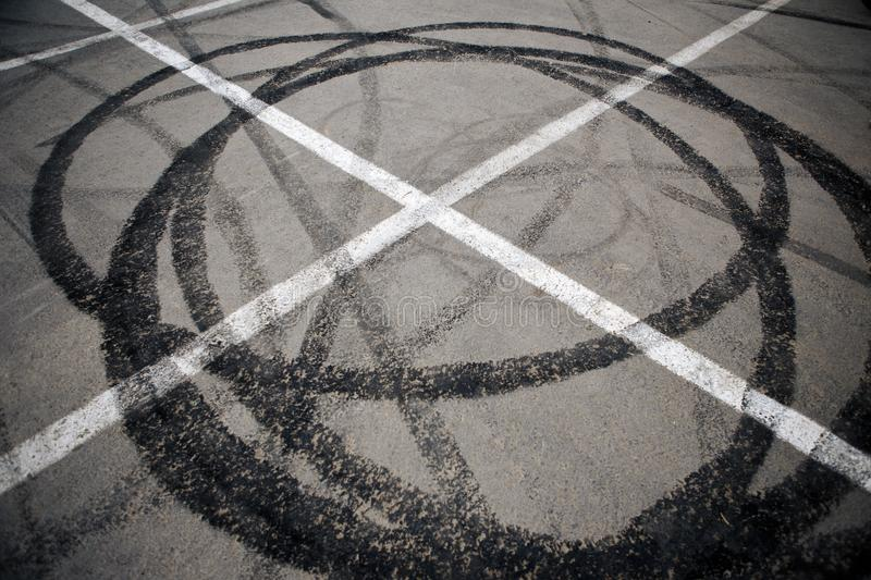 Trace of motorcycle tire on the asphalt in a parking lot stock images