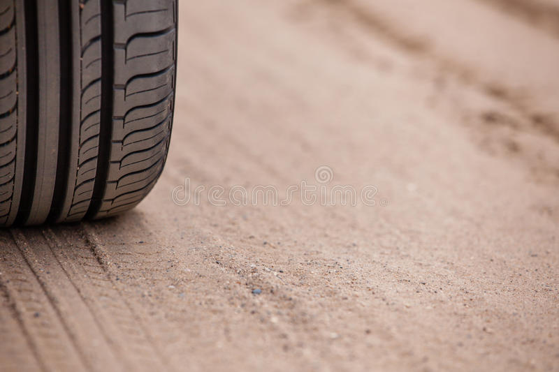 Trace of rubber tires SUV in the desert sand. Off road 4X4 wheel tracks on country desert beach road sand motoring background image stock photography