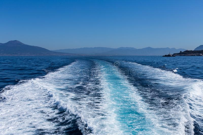 Trace tail of speed boat on water surface in the sea-nature and sport background. royalty free stock images