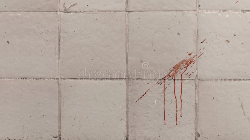 The traces of blood on the tiled wall stock photos