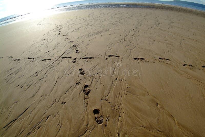 Traces en sable photographie stock