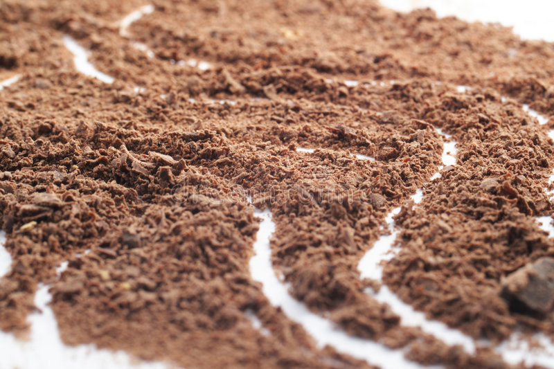 Traces in grated chocolate royalty free stock photography