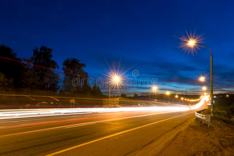 Traces of moving cars lights. On highway royalty free stock image