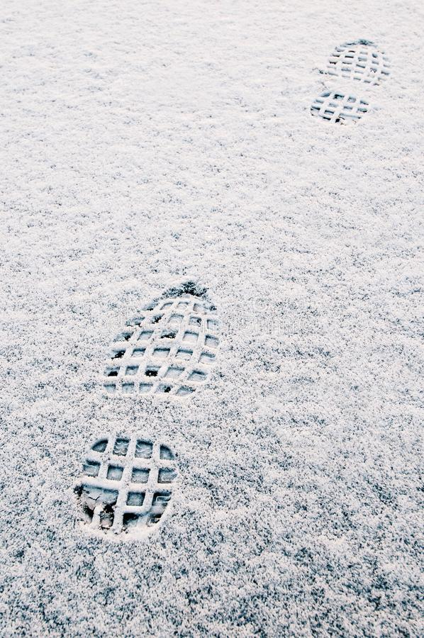 Traces of shoes soles in the snow stock photos