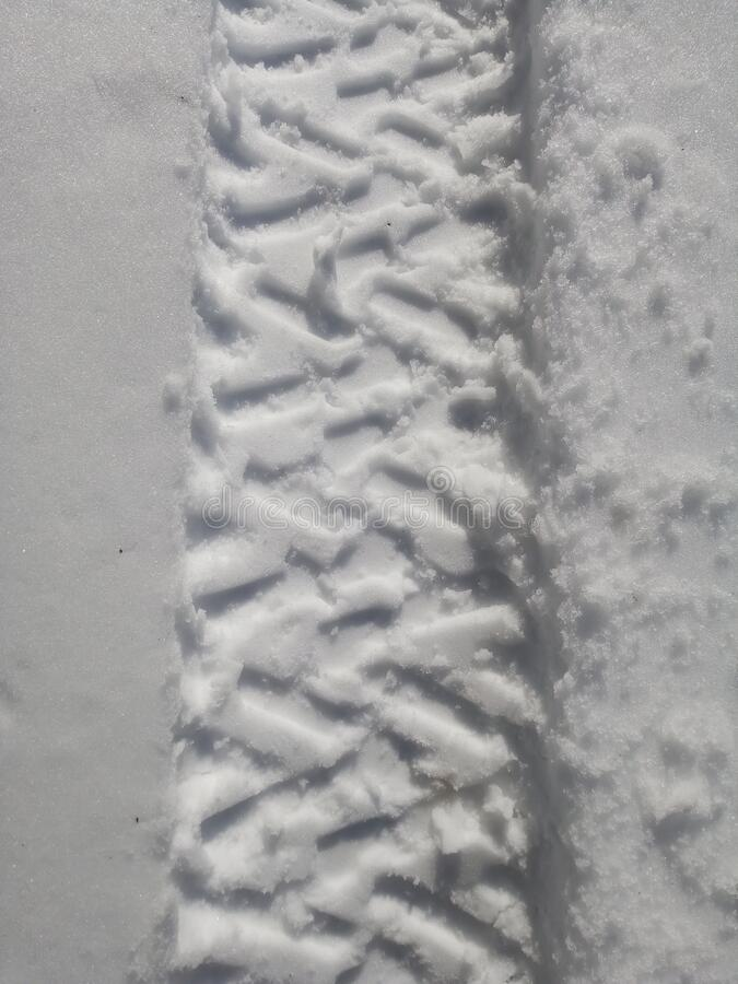 traces of snowmobiles and quads royalty free stock images