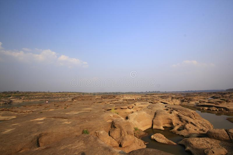 Traces of water eroded rocks. Traces of water that erode stones are of various shapes stock images