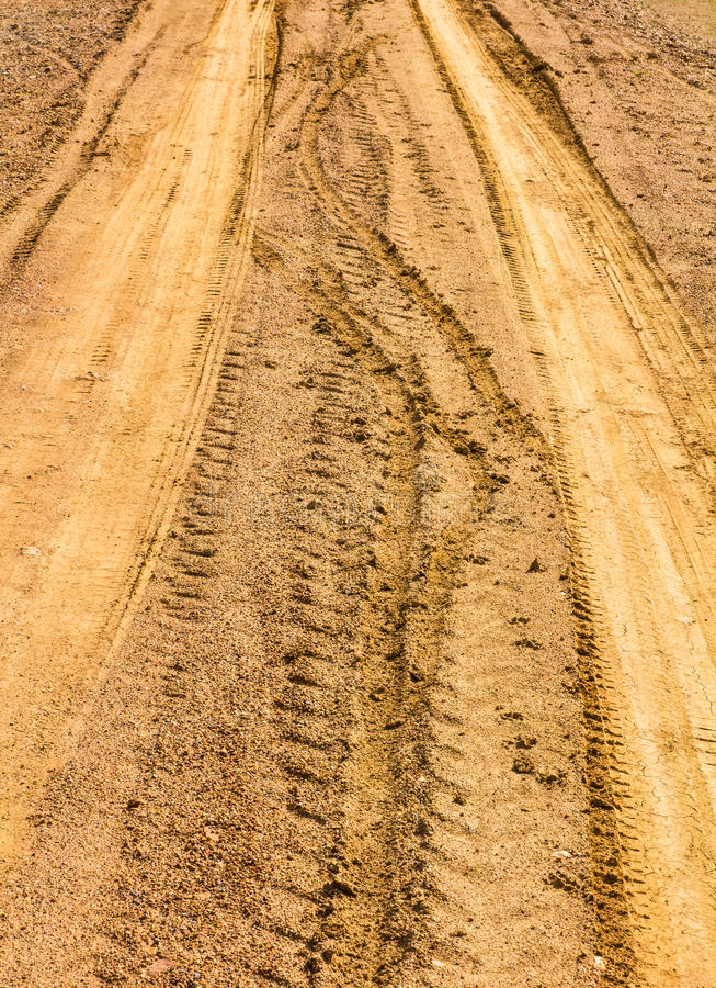 Traces of wheeled. Vehicles used in agriculture on a dirt road stock photo