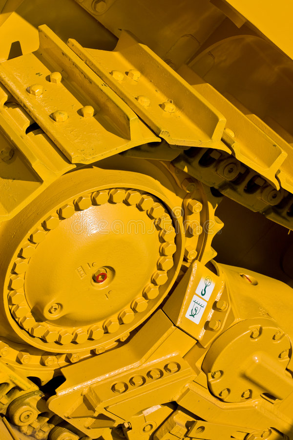 Track. Machinery series: yellow painted track of heavy bulldozer royalty free stock image