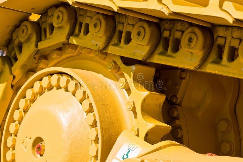 Track. Machinery series: yellow painted track of heavy bulldozer stock photos