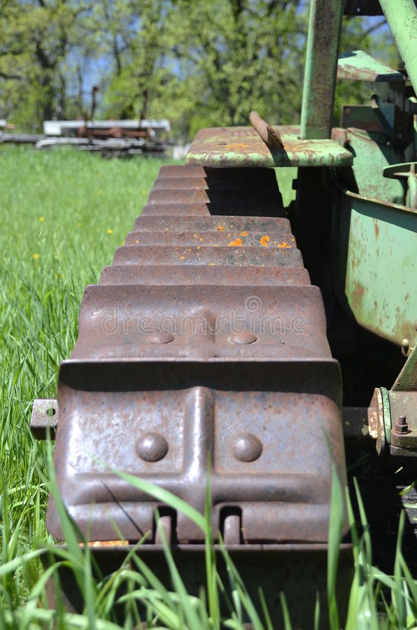 Track of a bulldozer. The rusty track of a bulldozer has rusty cleats for better traction stock photos