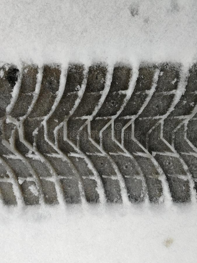 Track from car wheel tread in winter stock images