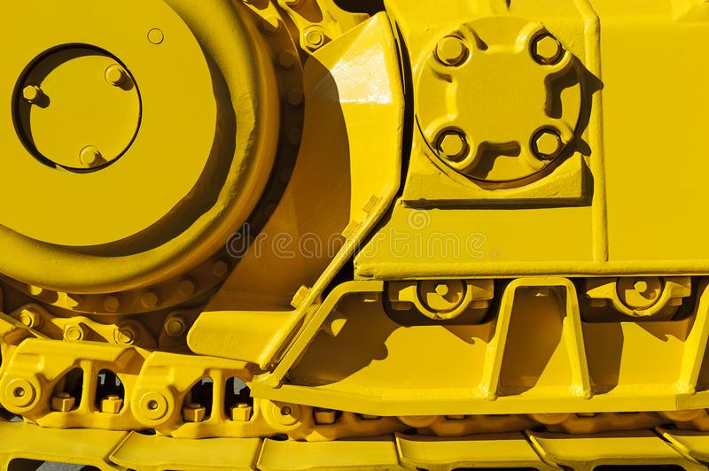 Bulldozer drive gear. Track drive gear, bulldozer sprocket mechanism, large yellow construction machine with bolts, heavy industry, detail royalty free stock photos