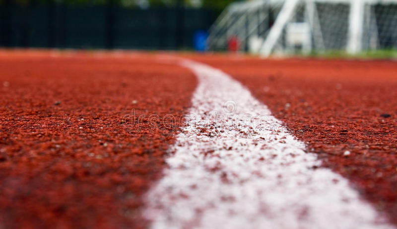 A track field. A track and field track for running and walking stock image