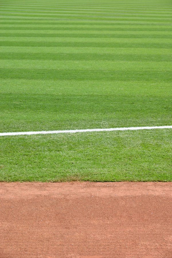 Track & Field 2. A white chalk line on a grassy field. Ready for a sporting event stock photos