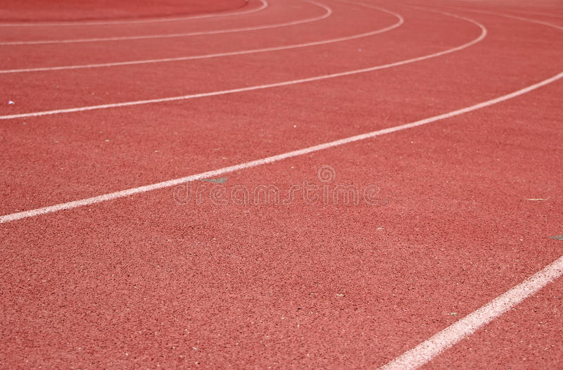 Track and Field. Shot of a red track and field ground for background stock photos