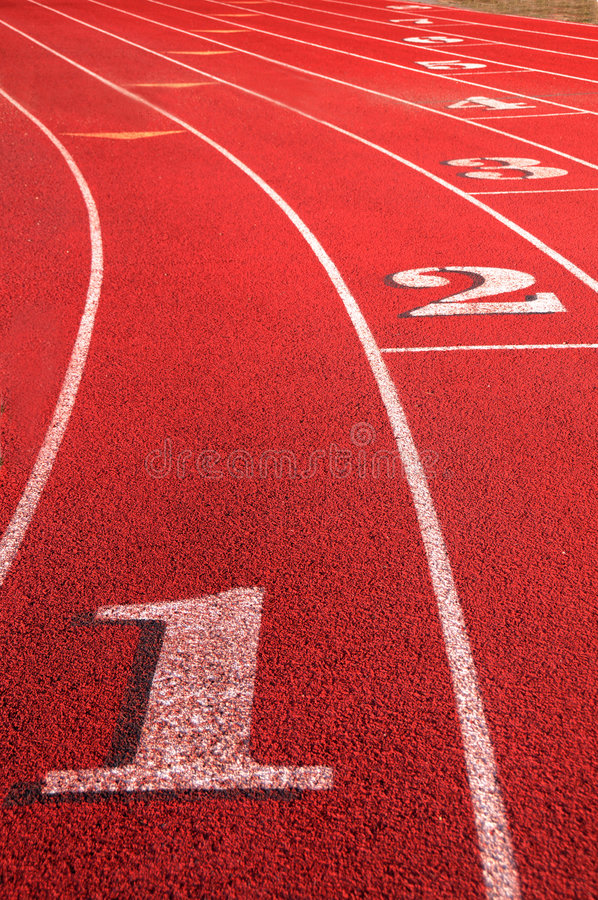 Track Field rounding first curve lane numbers stock photos