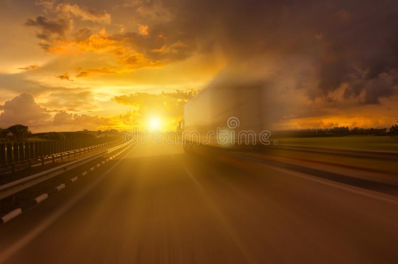 Track in motion blur on rvrning highway. Fast delivery anywhere in the world royalty free stock photography