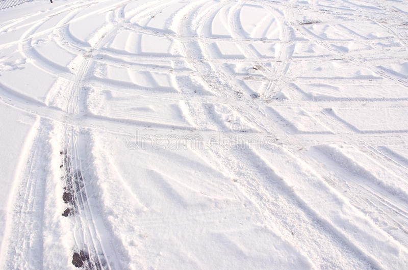 Track in the snow. Car tire track in fresh light snow stock photography