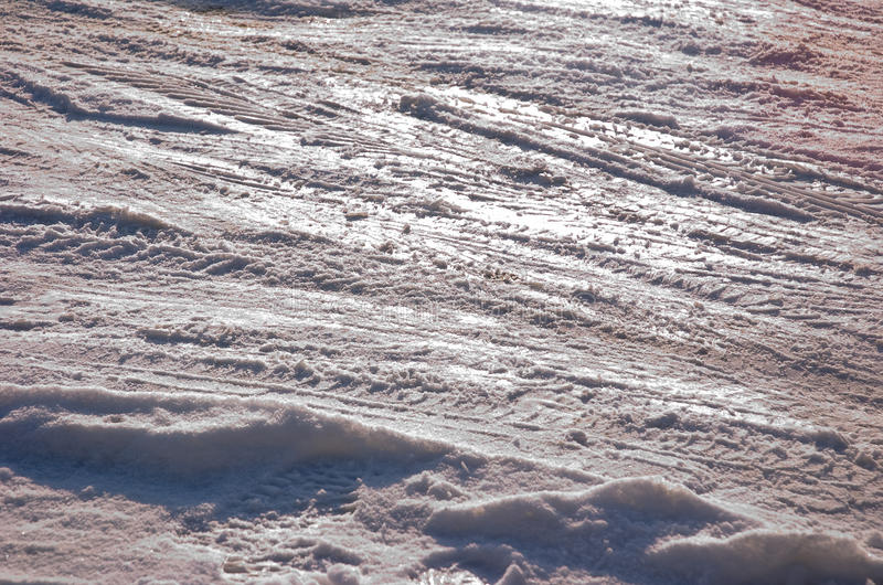 Track in the snow. Car tire track in fresh light snow stock photo