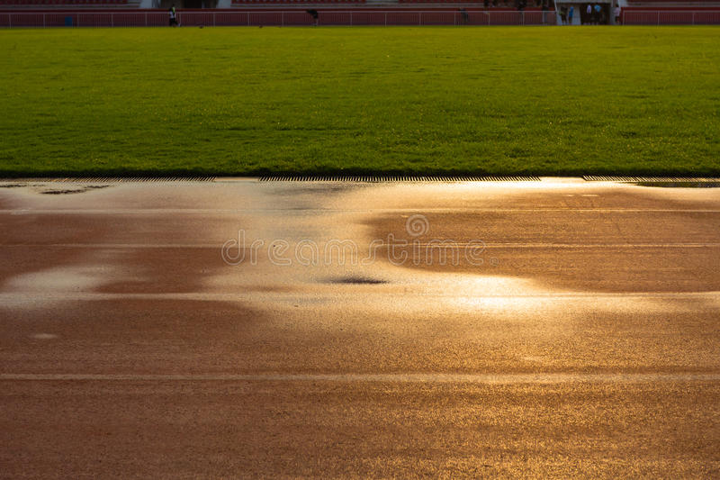 Track at Stadium , Bangkok in Thailand. Track running at Stadium with reflect the sun , Bangkok in Thailand royalty free stock images