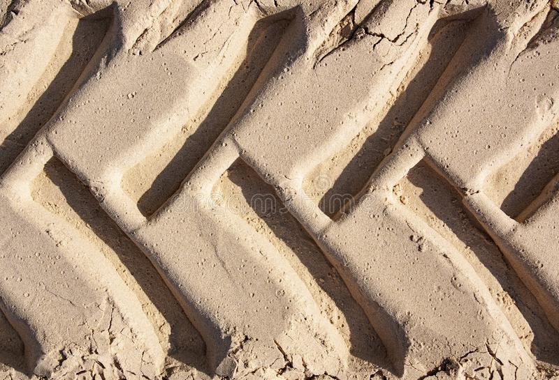 The track of the tractor wheels in the sand stock photography