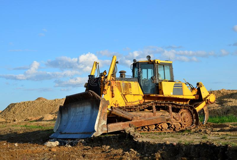 Track-type bulldozer, earth-moving equipment. Land clearing, grading, pool excavation, utility trenching, utility trenching stock images